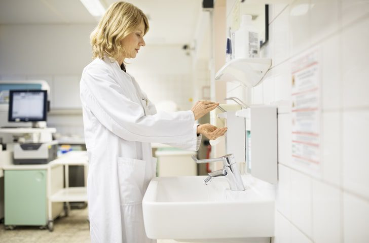 A doctor pumps soap into her hands at a wash station in a hospital. Hospital infections are the result of several medical malpractice lawsuits every year.